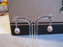 Orecchini in oro bianco con perle e diamanti